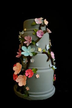 Grey with bright colored flowers. I know you were looking for cupcakes but I thought I would also add this cake as it just seemed so perfect!
