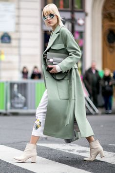 We open our street style roundup from day 7 of Paris Fashion Week with Eleonora Carisi in a horse-print jumpsuit with a plunging neckline, broken only by the season's mandatory accessory: the black...