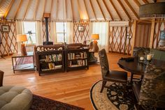 30' lounge with a connecting tunnel to another 30' yurt on the right side of the pic.