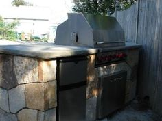 Learn how to build an outdoor bar and grill as part of a distinctive stone outdoor kitchen from the experts at DIYNetwork.com.