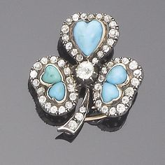 A late 19th century diamond and turquoise trefoil brooch/pendant, circa 1890 Each leaf set to the centre with heart-shaped cabochon turquoise within an old brilliant-cut diamond surrounds, to an old brilliant-cut diamond centre and stem, diamonds approx. 1.20ct. total, length 3.0cm.