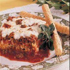 Pepperoni Lasagna Recipe Recipe Main Dishes with ground beef, onion, water, tomato sauce, tomato paste, beef bouillon granules, parsley flakes, italian seasoning, salt, garlic salt, eggs, small curd cottage cheese, sour cream, lasagna noodles, pepperoni, part-skim mozzarella cheese, grated parmesan cheese