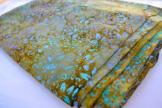 Batik Cloth Napkins in Green with Blue, Set of 4 by Dot and Army. $16.00, via Etsy.  I am LOVING this print!