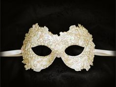Venetian style glamorous bridal mask covered with cream applique leaves and beads, faux ivory pearls, slightly irridescent transparent sequins. Your order will be delivered within 3-5 business days with online tracking by DHL or UPS. Contact number is required to be given to shipment agency. Please note that delivery will be made by signature confirmation so somebody should be ready at the address to accept the package.  Back surface is covered with fabric for comfortable use. Ribbons added…