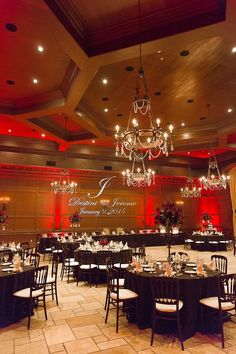 pink ballroom with mood up lighting black linens and projected