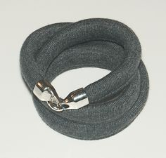 Triple cotton bracelet with a hook.