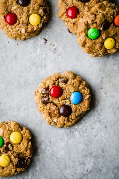 Incredible healthy monster cookies packed with peanut butter flavor, chocolate chips, coconut, chocolate candy pieces and nuts. These flourless monster cookies are a wholesome take on a childhood classic you know and love! Easy to make and great for customizing. #cookies #monstercookies #oatmealcookies #glutenfree #flourless #healthybaking #healthydessert Healthy Cookie Recipes, Healthy Cookies, Healthy Baking, Healthy Desserts, Gourmet Recipes, Dessert Recipes, Free Recipes, Paleo Treats, Vegan Snacks