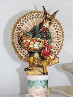 RESERVED for Donna Vintage Victorian Inspired Easter Dressed Rabbit  with a Basket of Eggs on a Spool Rosette Bunny