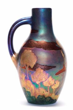 Sándor Apáti Abt for Zsolnay A Lustre Vessel, circa 1898 of bottle form with a single handle, decorated with stylised trees in a rolling landscape in shades of purple, red and golden iridescence high, printed factory mark Porcelain Ceramics, Ceramic Art, Antique Vases, Art Tiles, Art Object, Jewel Tones, Shades Of Purple, Art Deco Fashion, Pottery Art