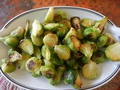 Roasted Brussels sprouts (from frozen!).  Results:  site is down, but recommends olive oil spray and salt, 425 degrees for 20 minutes.  Works great.