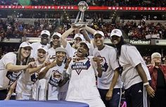 Members of the Fever celebrate after winning their 1st WNBA title