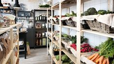 Pantry idea wood shelves with rattan baskets filled with vegetables