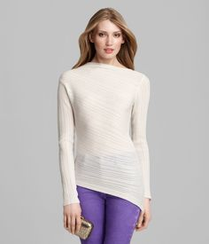 CORDELIA SWEATER    The diagonal stripe effect and asymmetric hem of the Cordelia sweater flatter every figure. With a feminine boat neck and long sleeves it is the perfect layering piece to keep you both warm and stylish all winter long.