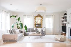 The space, once a carriage house of the nearby grand Victorian, is bright and spacious, with soaring ceilings.
