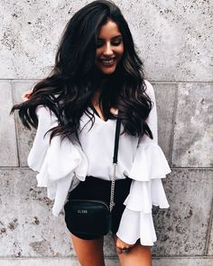 Pretty white ruffled blouse with black.