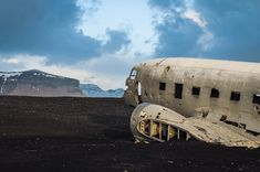 Abandoned airplane wreckage by a mountain landscape Coast Tops, Mountain Vacations, Europe, Outdoor Photos, Beautiful Waterfalls, Iceland Travel, Mountain Landscape, Natural Wonders, Abandoned Places