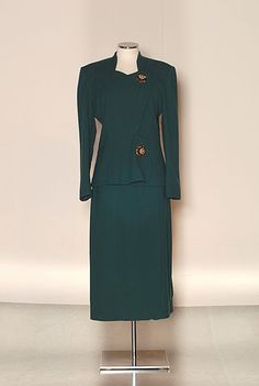 1948 Schiaparelli suit with large ornamental buttons. PFF Collection.