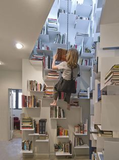 It's a cliff face of books!: Incredible Home Bookcase Climbs 40 Feet of Interior Walls #books #architecture