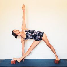DAY 10, PART 2. (See previous post for an easier version of triangle pose) I struggled with finding a way to make trikonasana harder than it is, without being ridiculous. One could take it with both feet on the wall and the hand on the floor. Perhaps...