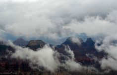 Clouds dance past the temples in Grand Canyon