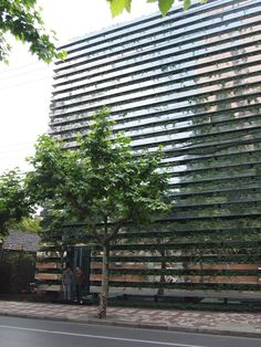 Kengo Kuma's office building in Shanghai. Horizontal plantings clad in mirrored finished steel.
