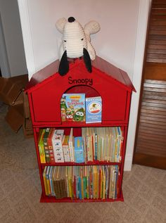 Book shelf designed by me built by hubby! So proud of our first woodworking project! My m-i-l was so sweet to find a Snoopy doll for us to put on top!