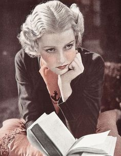 Actress Anita Louise Reading, 1933.  Louise (1921-1970) made her acting debut on Broadway at the age of six, and within a year was appearing regularly in Hollywood films. By her late teens she was being cast in leading and supporting roles in major productions, and was highly regarded for her delicate features and blonde hair. Shewas frequently described as one of cinemas most fashionable and stylish women. Film successes included Madame Du Barry (1934) and A Midsummer Night