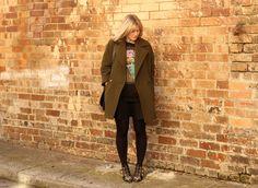Liz Elton, Art Director Balenciaga top, Country Road skirt, Helene Berman London coat, Chloe boots, Karen Walker ring, Givenchy bag.