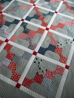 Simple quilt pattern made great with excellent quilting! http://sewkindofwonderful.blogspot.com/2013/05/jodis-beautiful-quilt.html