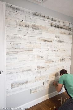 Reclaimed wood wall with Stikwood peel and stick painted wood.