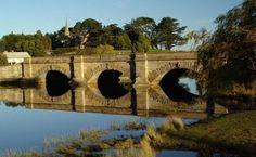 This Tasmanian bridge was built by convicts in Ross in Photo by Dan Fellow. Port Arthur, Southport, Tasmania, Australia Travel, East Coast, Places Ive Been, Battle, Landscape, History