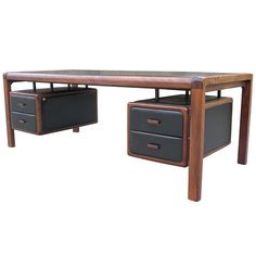 Exceptional large black leather and mahogany desk | From a unique collection of antique and modern desks at http://www.1stdibs.com/furniture/storage-case-pieces/desks/