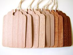 Love these wooden favor tags from The Woody Beckers http://www.etsy.com/shop/thewoodybeckers