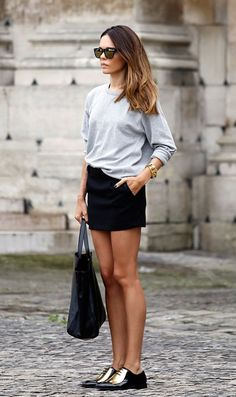 Shop this look on Lookastic:  http://lookastic.com/women/looks/sunglasses-crew-neck-sweater-bracelet-mini-skirt-tote-bag-oxford-shoes/9132  — Dark Green Sunglasses  — Grey Crew-neck Sweater  — Gold Bracelet  — Black Mini Skirt  — Black Leather Tote Bag  — Black and Gold Leather Oxford Shoes