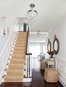 Cottage foyer boasts a traditional staircase clad in wainscoting lined with a bound sisal runner indoor outdoor by Sacco Sisal Stair Runner, Staircase Runner, Stair Runners, Navy Stair Runner, Traditional Staircase, Coastal Living Rooms, Foyer Decorating, Decorating Ideas, Decor Ideas