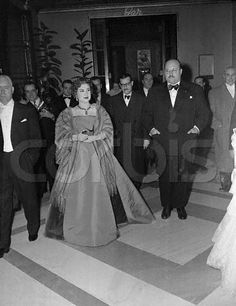 12 Dec 1952, Rome, Italy --- Farouk Goes to the Opera. Rome: The Ex-King Farouk of Egypt and ex-Queen Narriman, dressed in a slate grey satin evening gown and mink cape, attend the opening night performance of Verdi's  at Rome's Opera House. The deposed monarch and his wife sat in a reserved box and applauded enthusiastically during the opera. --- Image by © Bettmann/CORBIS