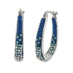 Crafted in 18Kt White Gold Over BrassMontana Blue Crystals Made With Swarovski ElementsInside Out CrystalsGraduated ombre DesignSecure French LockHypoallergenic Dimensions: 35mm x 5mm x 25mm