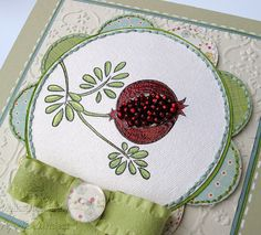Seed beads sewn on the card to form the pomegranate