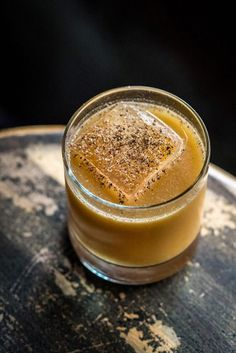 Winter Traveler's Punch - dark rum, spiced rum, Ancho Reyes, orgeat, pineapple juice