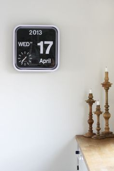 Annixen http://www.amazon.com/Karlsson-Calendar-Clock-Flip-White/dp/B000OC09AU
