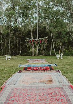 For a boho celebration, a row of Persian rugs can create a stunning aisle runner.