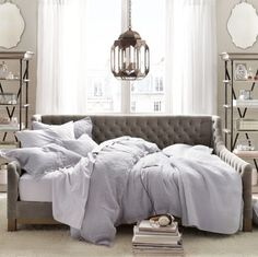 An elegant daybed is perfect for a fancy guest suite as it can be used as a sofa during the day and bed at night.