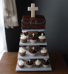 This was for my son's First Holy Communion. He prefers buttercream over fondant, but my expertise is in fondant. It's not too bad though. All of the crosses are chocolate. I made the stand. The cake is peanut butter cake with chocolate filling and frosting. The cupcakes are double chocolate and yellow with strawberry filling.