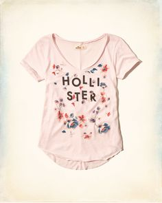 Top with a seriously-soft tee featuring pretty pattern, front graphic, a v-neck with rugged trim and curved hem, Imported
