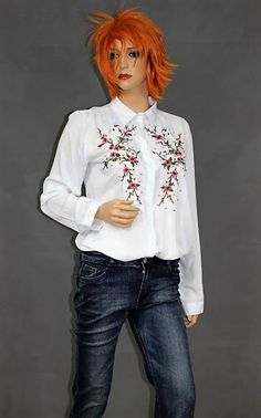 White elegant shirt decorated with flowers