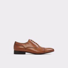 Saylian Polished to perfection,this burnishedleather oxford extends style from the office to date night. Built up sole and smooth,almond toe is as dressy as a shoe can get, made to punctuate suits and tapered trousers.