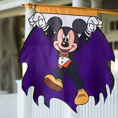Halloween Mickey Mouse Flag 2010 Count Mickey welcomes all vampires and trick or treaters to your haunted home with our Halloween Mickey Mouse Flag!  Product Details•Mickey dressed as a vampire art  •Rod pocket on top for hanging  •Flag pole not included  •Nylon  •30'' x 30''  •Imported    59.99
