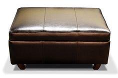 Кожаный пуфик в современном стиле. Обивка полностью в итальянской коже. Декорирован буковыми ножками, каркас из массива дерева хвойных пород и фанеры. Возможно изготовление по индивидуальным размерам.