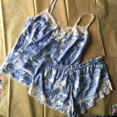 Victorias Secret 2PC satin Pajamas! NWOT Victorias Secret 2 piece pajamas! Blue and white paisley design! Tank and shorts! Adjustable top straps and drawstring on shorts! New without tags! Victoria's Secret Intimates & Sleepwear Pajamas