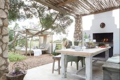 By Simone Borcherding stylist   writer   spacemaker. Verandah with limewashed whitewashed walls, reed latte, outdoor bbq, stone-clad pillars, succulents, rustic furniture and a hanging daybed.
